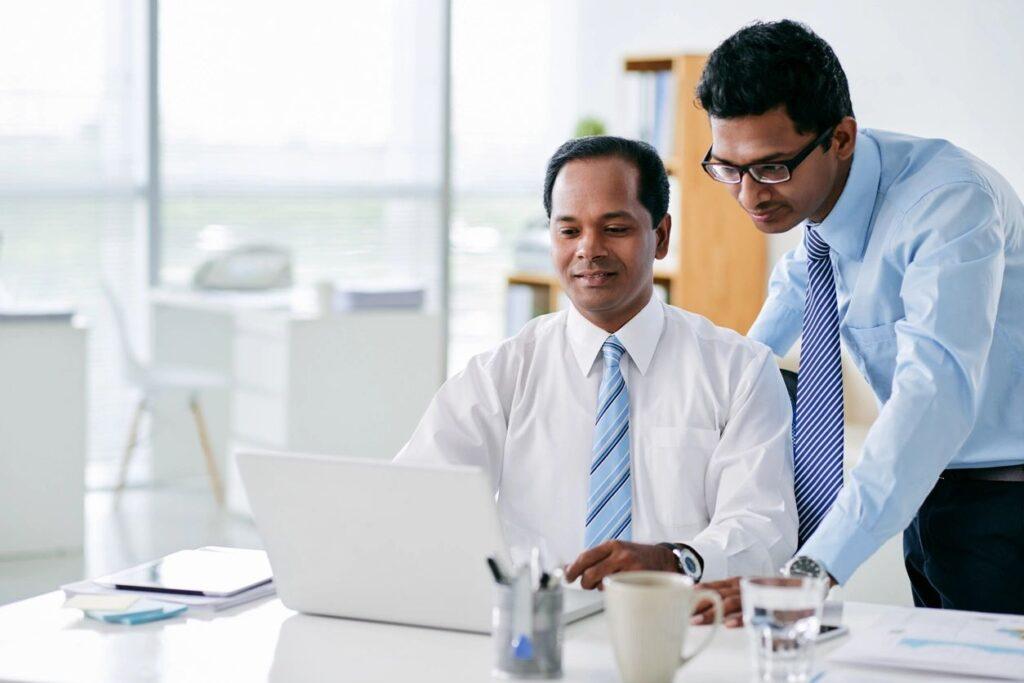 Men looking at computer screen
