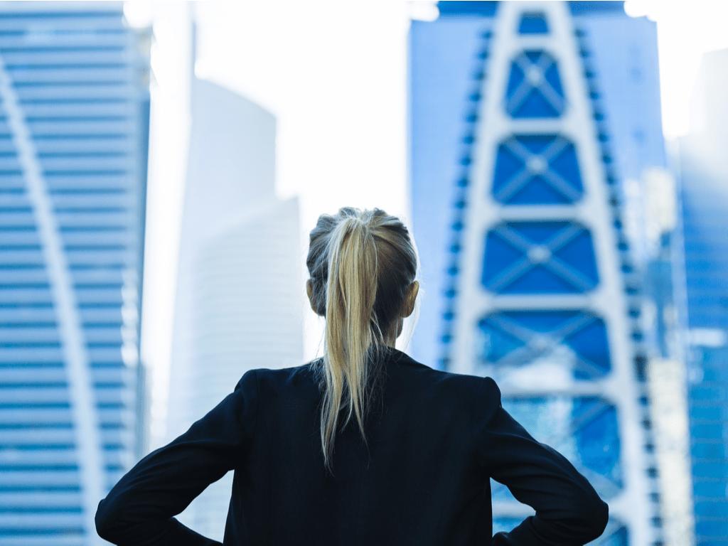 Woman power posing at city
